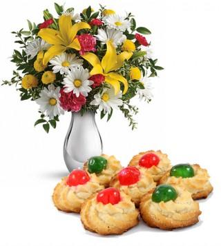 consegna-torta-dolcetti-di-mandorle-e-bouqute-di-giglie-e-margherite