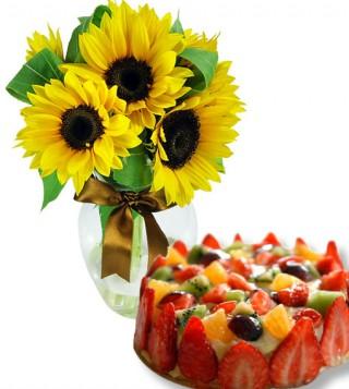 torta-alla-frutta-con-bouquet-di-girasoli